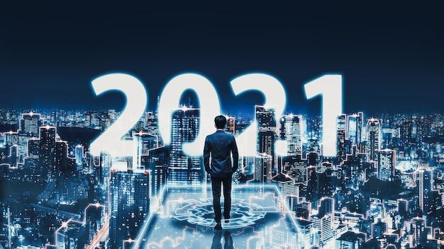 Conceito de tecnologia de negócios, homem de negócios profissional andando na rede futura, fundo da cidade de tóquio com texto de ano novo 2021 e gráfico de interface futurista à noite no japão