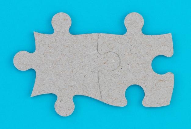 Conceito de trabalho em equipe empresarial e integração com quebra-cabeça.