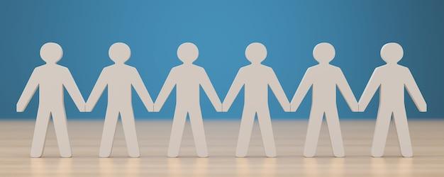 Conceito de trabalho em equipe figuras de pessoas de mãos dadas na superfície da madeira