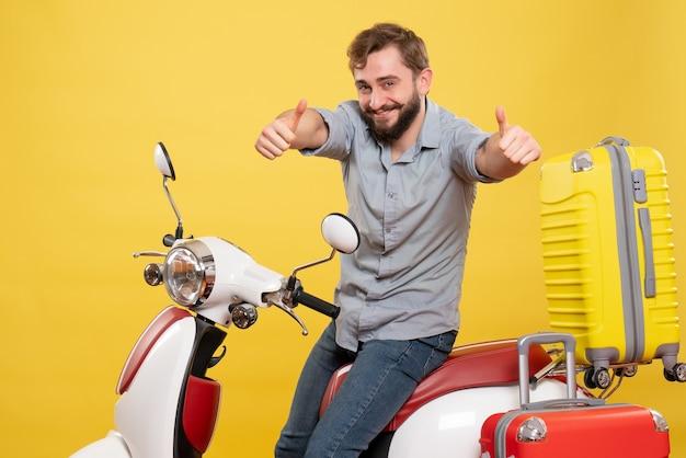 Conceito de viagens com jovem sorridente barbudo feliz sentado na moto e fazendo um gesto de ok sobre ela em amarelo