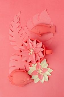 Conceito de vida coral. conjunto de brinquedos de peixe e flores de papercraft de origami