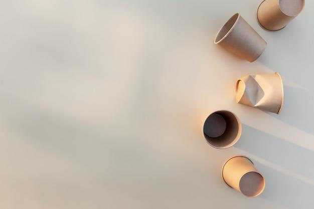 Conceito de zero desperdício e reciclagem com copos de embalagem de papel kraft ecologicamente correto e canecas espremidas para comida para viagem com efeito de sombra