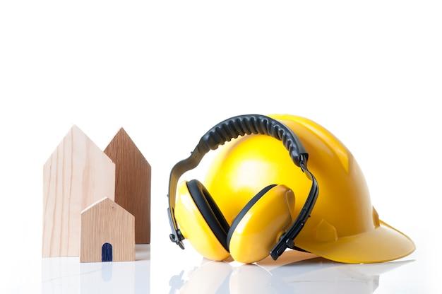 Conceito dos materiais da segurança da construção da casa e de construção. ferramentas de segurança de construtor de casas.