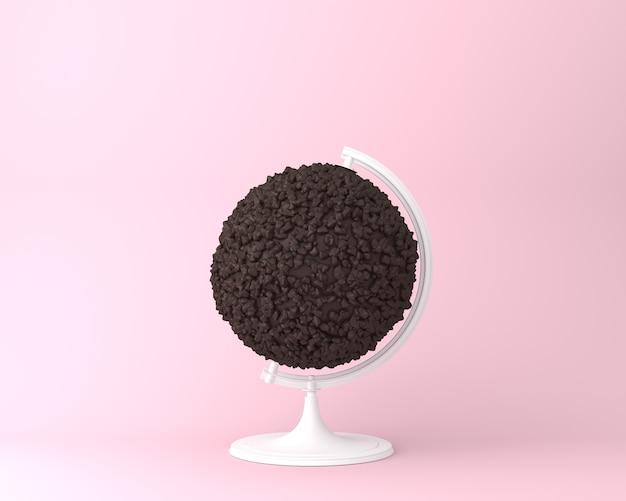 Conceito dos pedaços de chocolate da esfera da esfera do globo no fundo do rosa pastel. conceito de ideia mínima.