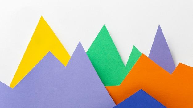 Conceito gráfico com vista superior de papel colorido