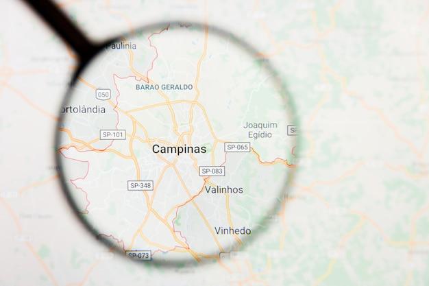 Conceito ilustrativo de visualização da cidade de campinas, brasil, na tela de exibição através de lupa
