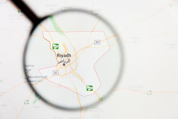 Conceito ilustrativo de visualização da cidade de riade, arábia saudita na tela de exibição através de lupa