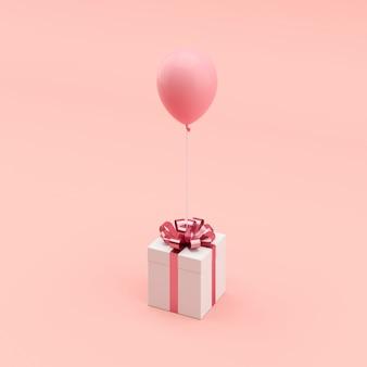 Conceito mínimo. caixa de presente branca pendente com fita rosa com balão rosa sobre fundo azul.