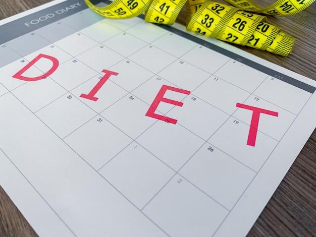 Conceito plano de dieta. fita métrica e plano de dieta