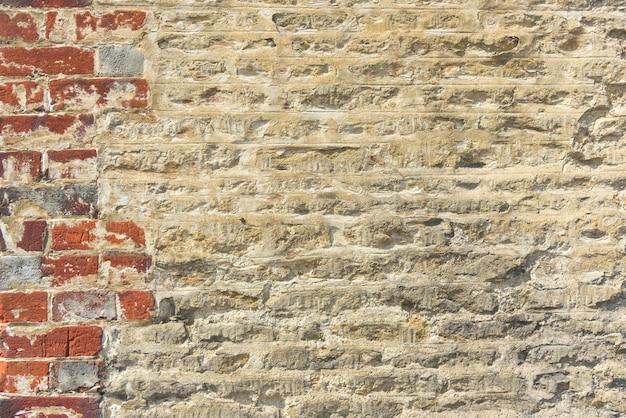 Conceito velho do teste padrão da alvenaria de grunge da fachada do tijolo