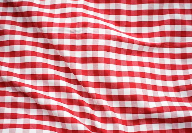Conceito verificado vermelho da toalha de mesa da decoração