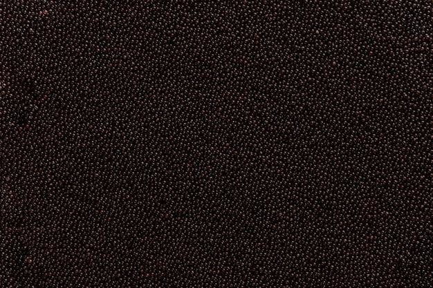 Confeção granulada de chocolate preto para brigadeiro brasileiro.