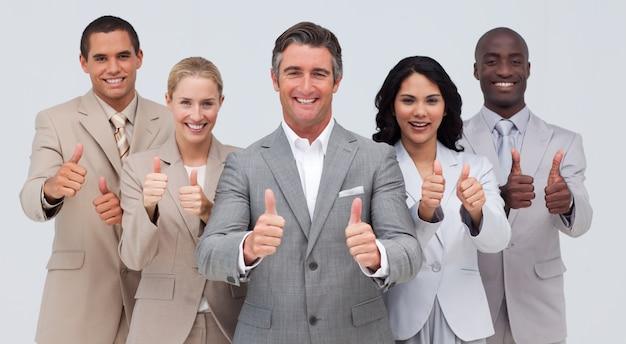 Confiável equipe de negócios com polegares para cima