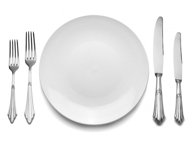 Configuração com placa, facas e garfos