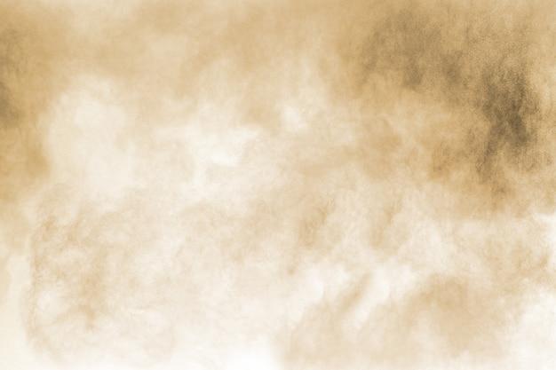 Congelar o movimento da explosão de poeira marrom.
