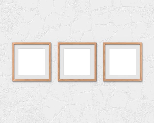 Conjunto de 3 maquete de molduras quadradas de madeira com uma borda na parede. base vazia para imagem ou texto. renderização em 3d.