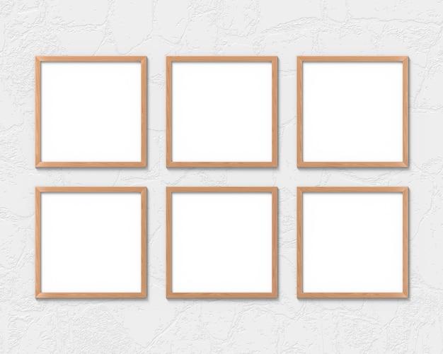 Conjunto de 6 maquete de molduras quadradas de madeira pendurado na parede. base vazia para imagem ou texto. renderização em 3d.