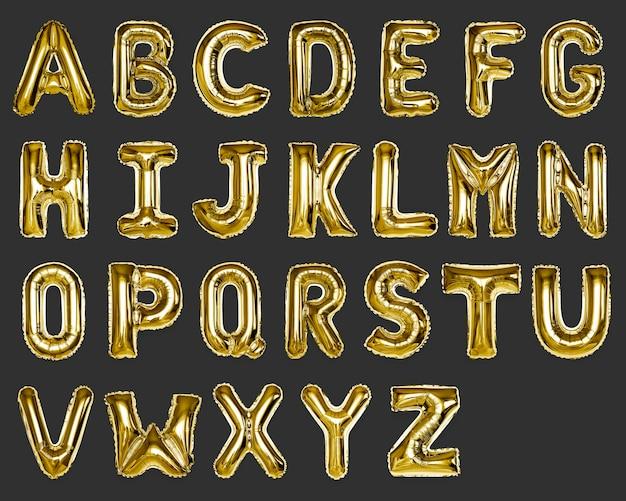 Conjunto de balões com letras maiúsculas az ouro