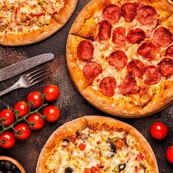 Conjunto de diferentes pizzas calabresa, vegetariana, frango com legumes