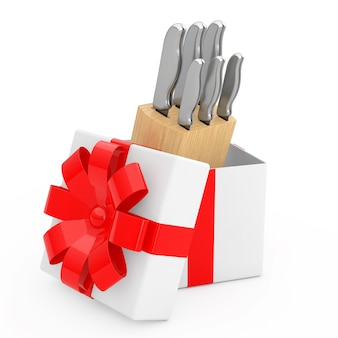 Conjunto de facas de cozinha profissionais em caixa de madeira que saem da caixa de presente com fita vermelha
