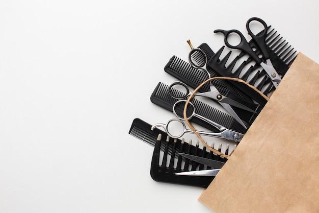 Conjunto de ferramentas de cabelo em saco de papel