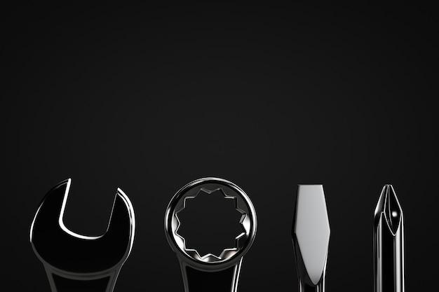 Conjunto de ferramentas de prata em uma linha em um fundo preto com espaço de cópia