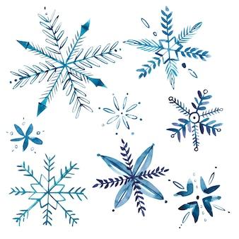 Conjunto de flocos de neve em aquarela, isolado no fundo branco.
