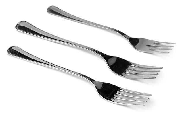 Conjunto de garfos de jantar isolado no fundo branco close-up