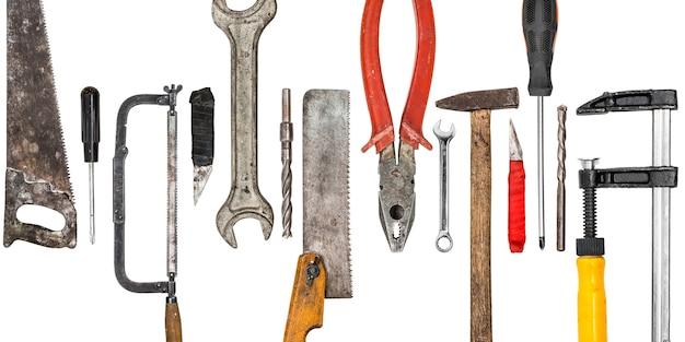 Conjunto de instrumentos de ferramentas artesanais profissionais isolado na superfície branca