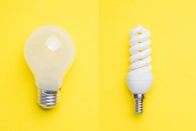 Conjunto de lâmpadas de poupança de energia e não na mesa amarela. foco seletivo