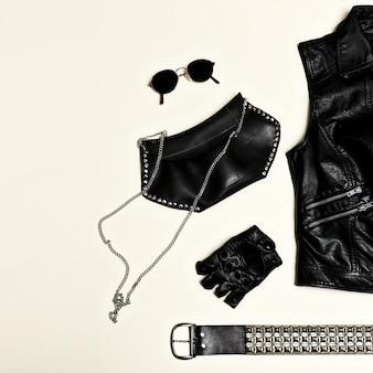 Conjunto de moda negra. mochila black vest e acessórios pretos. luvas de óculos. joias gorro, clutch estilo urbano