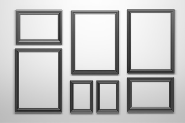 Conjunto de muitas formas diferentes quadros pretos na parede branca.