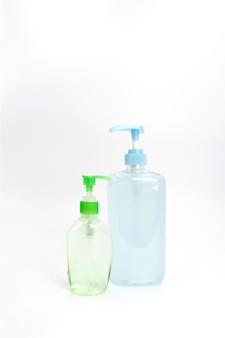 Conjunto de sanitizante gel de proteção azul e verde de proteção coronavírus (covid-19), isolado.