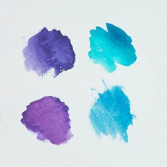Conjunto de tons diferentes de tintas aquamarine em papel branco