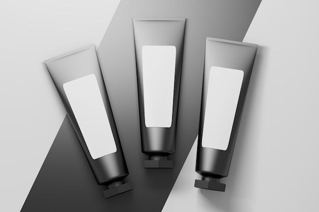 Conjunto de três pequenos tubos de embalagem de cosméticos pretos