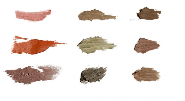 Conjunto de várias espessuras de manchas de cosméticos de cor no fundo branco isolado
