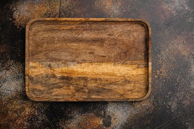 Conjunto vazio de tábua de madeira, vista de cima plana lay, com espaço de cópia para o texto ou seu produto, no fundo da velha mesa de madeira escura