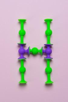 Construtor de otário como a letra do alfabeto inglês