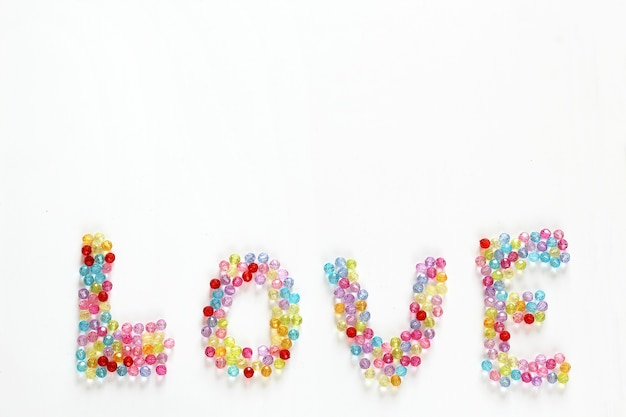 Contas coloridas adoram fundo e pano de fundo