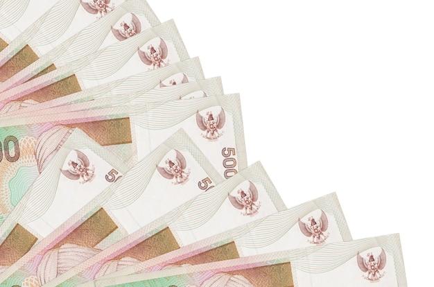 Contas de rupias indonésias na superfície branca