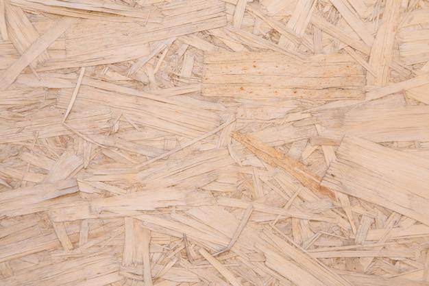 Contraplacado de aglomerado de madeira prensada closeup fundo aparas de madeira cópia espaço