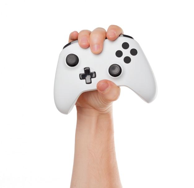 Controlador de console de videogame nas mãos de jogador isoladas