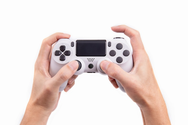 Controlador de jogos de joystick na mão isolado no fundo branco