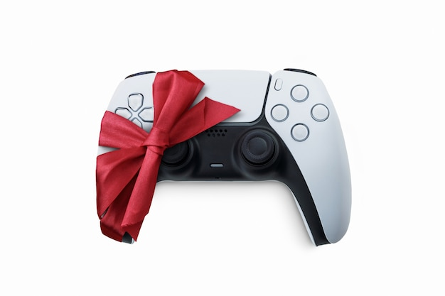Controle de jogo branco da próxima geração embrulhado com fita de presente do papai noel no natal