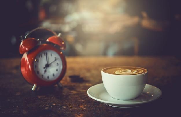 Copo de café da arte do latte do rosetta, café da manhã.