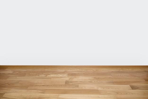 Copyspace fundo com uma parede branca vazia com um piso de madeira de madeira