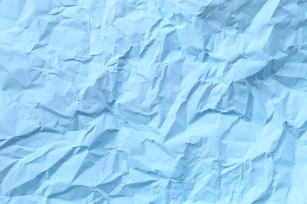 Cor ártica azul do fundo de papel amassado ou enrugado.