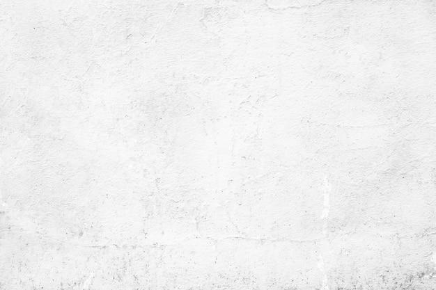 Cor branca do muro de cimento vazio do grunge para a textura.