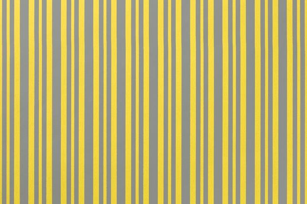 Cor da tendência do ano 2021 amarelo iluminante e cinza final. fundo neutro cinza e dourado de papel de embrulho com padrão listrado.