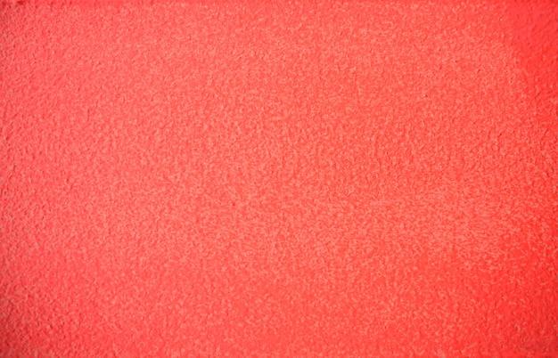 Cor viva coral pintado textura de parede de concreto backgrond